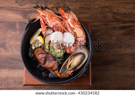 seafood in Iron bowl,  Korean food - stock photo