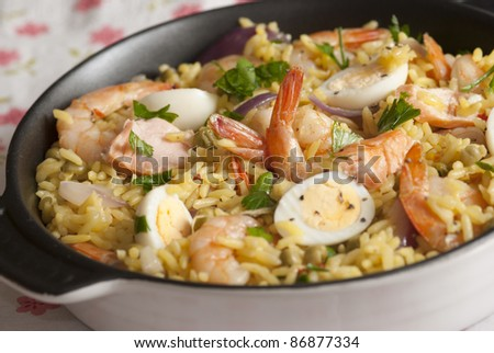 Seafood kedgeree with prawns, quail eggs, salmon and herbs