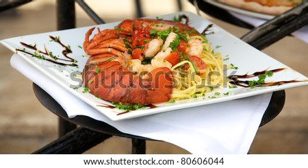Seafood linguine with fresh lobster - stock photo
