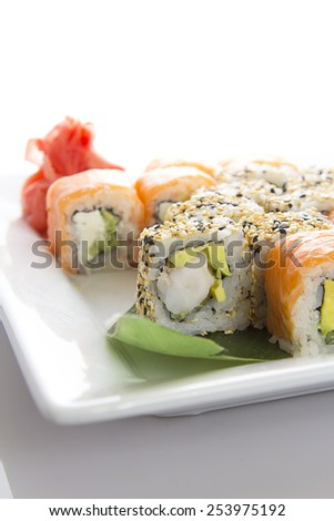 Seafood Maki sushi in white plate isolated on white background - stock photo