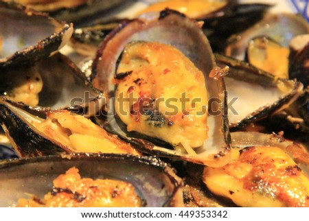 Seafood oysters with cheese, served in shells - stock photo