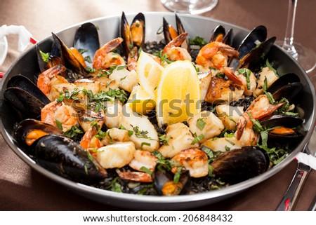 seafood paella in the fry pan - stock photo