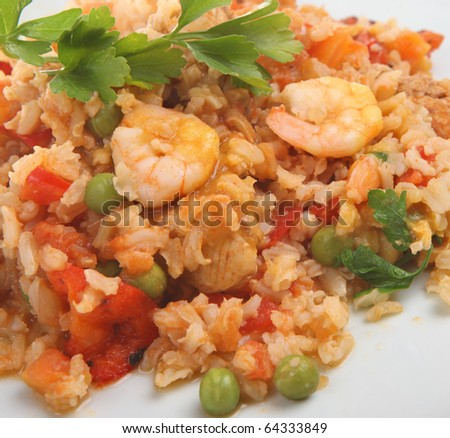Seafood paella with king prawns and scallops. - stock photo