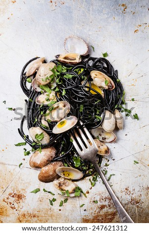 Seafood pasta with clams Spaghetti Vongole on steel textured background - stock photo
