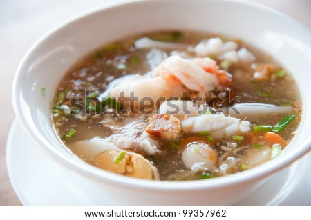 Seafood paste of rice flour (noodle) with egg, shrimp, mantis shrimp, squid and vegetables : delicious Thailand and Vietnam food