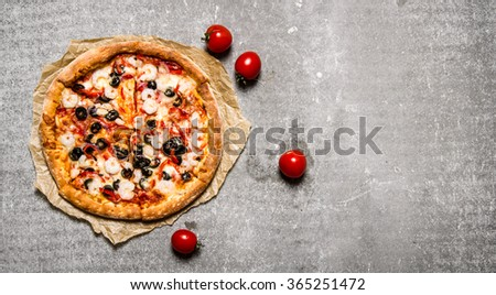 Seafood pizza with shrimp and tomatoes. On the stone table. Free space for text . Top view - stock photo