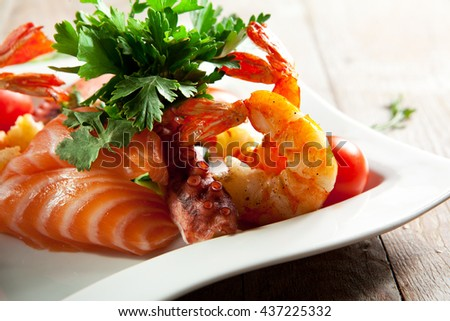Seafood Plate on Wooden Background
