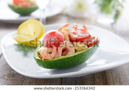 Seafood salad in avocado - stock photo