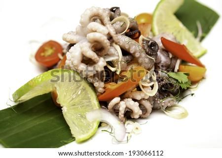 Seafood salad on white plateSeafood salad on white plate - stock photo