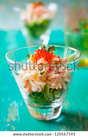 Seafood salad with calamari,crab meat  and red caviar - stock photo