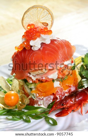 Seafood salad with red fish in restaurant