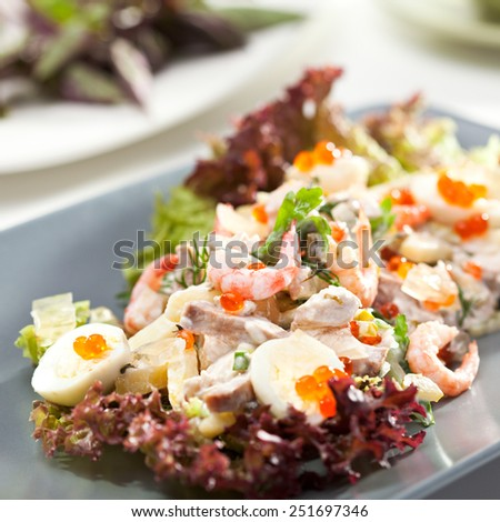 Seafood Salad with Shrimps, Quail Eggs, Red Caviar and Vegetables