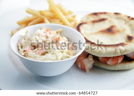Seafood sandwich with coleslaw on white background - stock photo