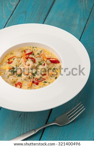 Seafood saute on the cyan wooden table