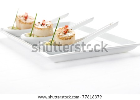 seafood scallop salad with a spoon