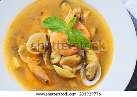 seafood soup with clams, mussel and prawn with veggies - stock photo