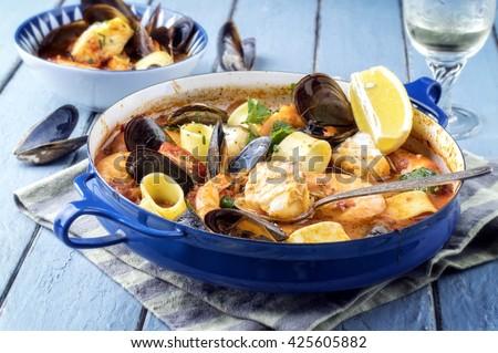 Seafood Stew in Saucepan - stock photo