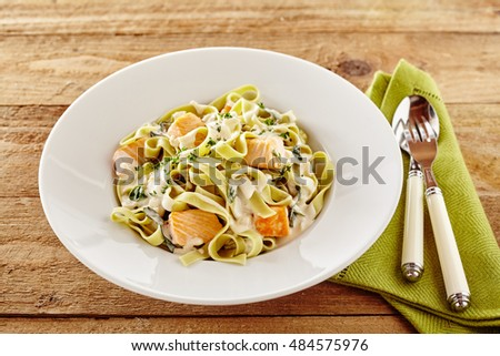 ... pasta with salmon fillet topped with a creamy sauce and fresh herbs