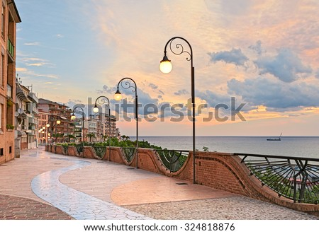 seafront at dawn in Ortona, Abruzzo, Italy - beautiful terrace with street lamp on the Adriatic sea   - stock photo