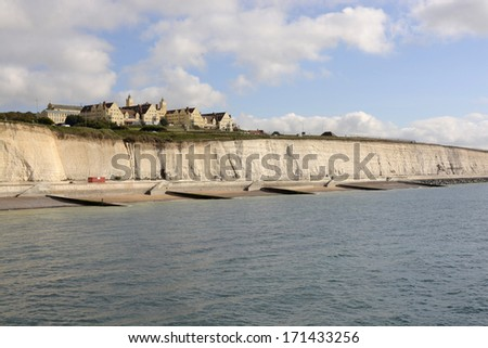 Seafront with chalk cliffs near the marina at Brighton. East Sussex. England with Roedean girls school on clifftop - stock photo