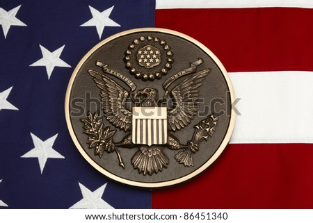 Seal of the United States shot on American flag close up - stock photo