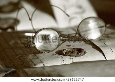 Sealed manuscript with ancient eyeglasses - stock photo