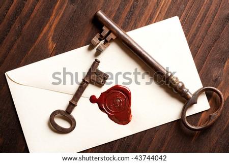 Sealed Valentine love letter with vintage rusty keys - stock photo