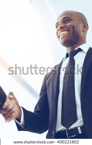 Sealing a deal. Close-up of low angle view of business men shaking hands - stock photo
