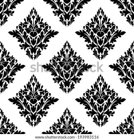 Seamless arabesque pattern with a diamond shaped floral motif in a repeat pattern in black and white suitable for textiles and wallpaper. Vector version also available in gallery - stock photo