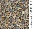 Seamless background from small stones to create endless texture - stock photo