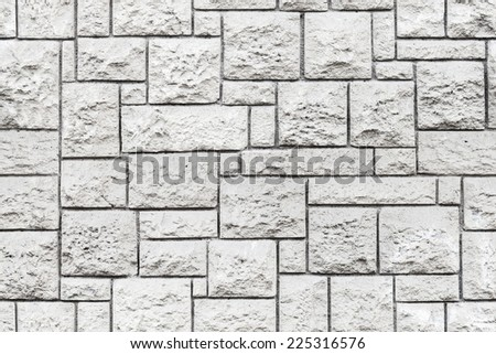 Seamless background texture of old gray decorative stone wall - stock photo