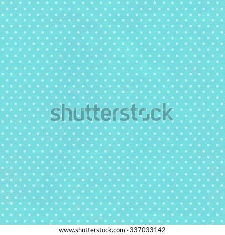 Seamless background with paper texture of blue color and dots pattern