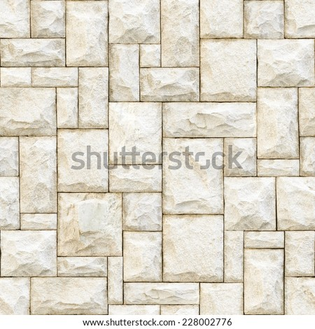 Seamless beige stony surface background. - stock photo