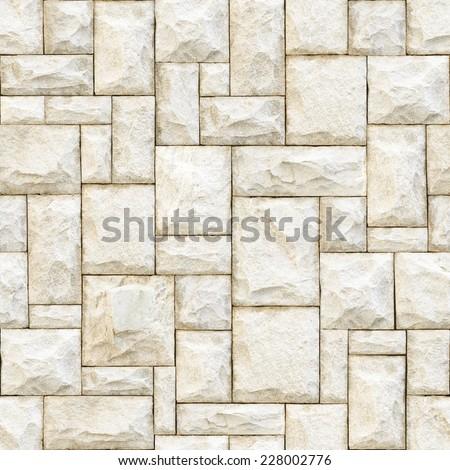 Seamless beige stony surface background. - stock photo