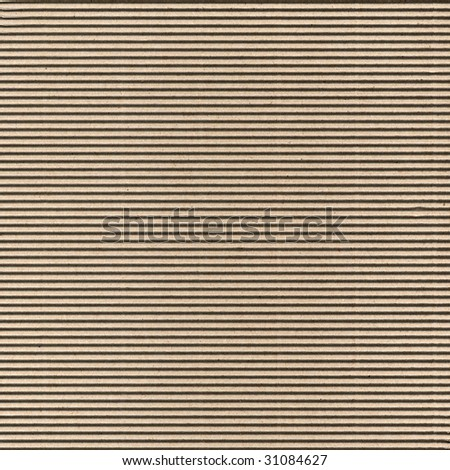 Seamless brown corrugated cardboard sheet useful as a background - stock photo