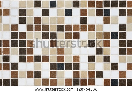 Seamless brown mosaic tiles wall - stock photo