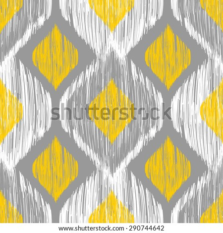 Seamless ikat pattern in yellow and grey colors. Tribal background - stock photo