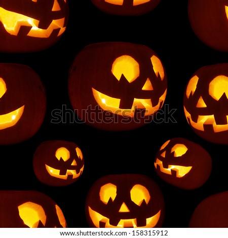 Seamless Jack-o'-lanterns pumpkin texture pattern as a Halloween background - stock photo