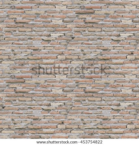 seamless old weathered brick wall background image - stock photo