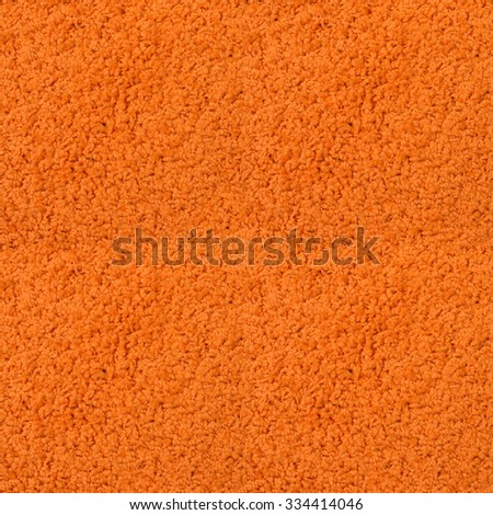 Seamless orange fitted carpet texture. - stock photo