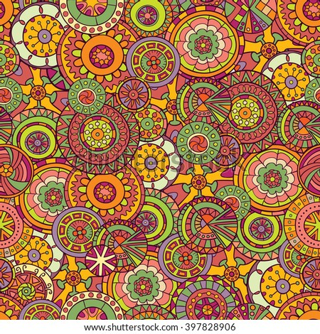 Seamless pattern of hand-drawn and painted mandalas.