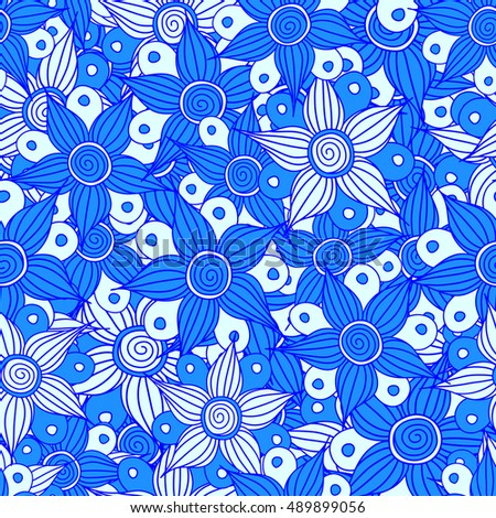 Seamless pattern of stylized floral motif, flowers, hole, spots, doodles in blue colors. Hand drawn. Seamless floral background.