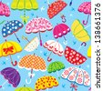 seamless pattern with colorful umbrellas on blue background. Raster version - stock
