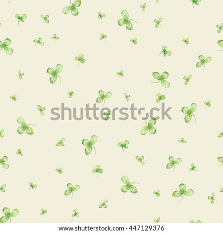 Seamless pattern with watercolor leaves of clover on beige background - stock photo