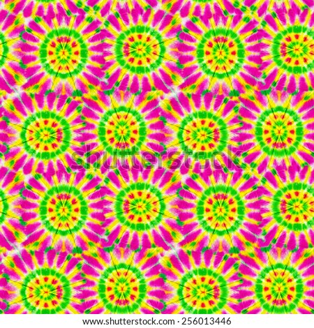 seamless tie dye in rastafari colors. African red yellow and green pattern. - stock photo