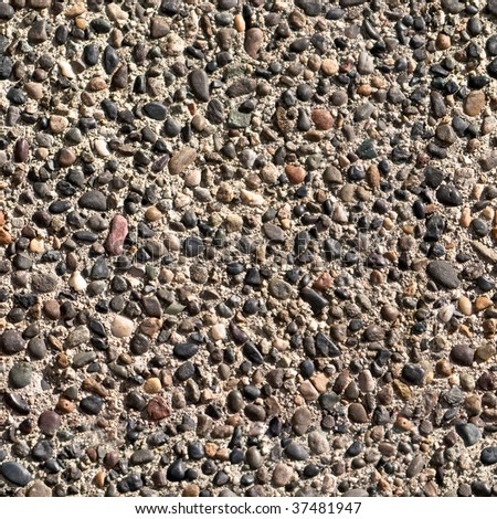 Seamless tile background of small stones on sidewalk or wall - stock photo