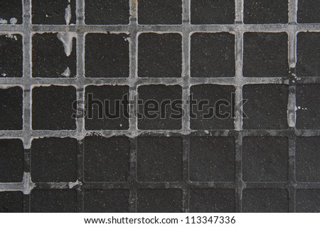 Seamless tileable grunge gray square marble stone background. - stock photo