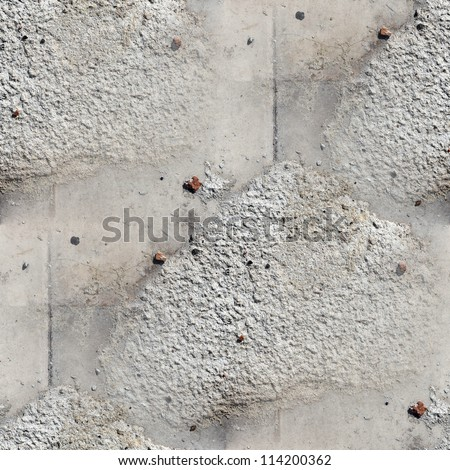 seamless wallpaper texture square of old stone wall with a crack background - stock photo