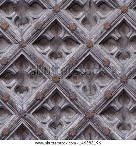 seamless weathered carving wood door texture with rusty nail - stock photo