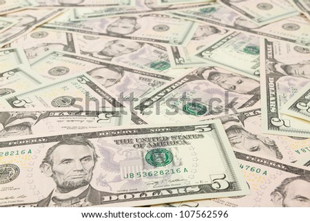 Seamlessly tileable and repeatable 5 dollar bills, US Currency - stock photo